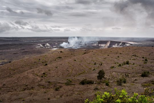 Hawaii Kilauea crater with smoke