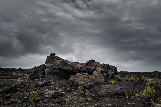 Hawaii lava rock with stormy sky