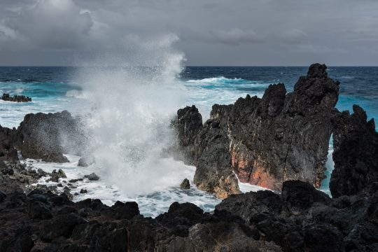 Hawaii wave crashing into rocks