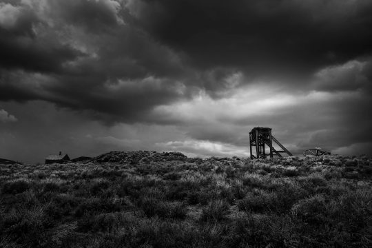 Old tower with stormy clouds in Bodi, California ghost town