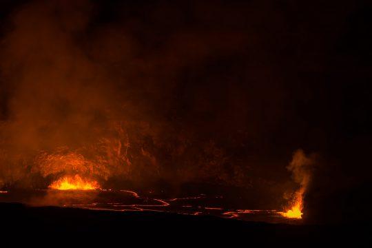 Hawaii Kilauea crater molten lava at night